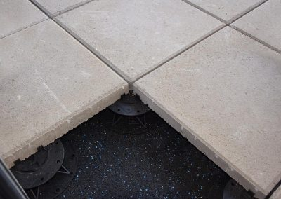 DAMTEC sonic under support pads and concrete slabs